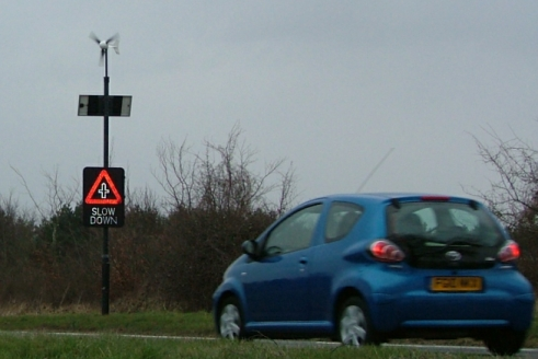Vehicle activated road signs powered by wind